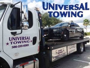 Florida Highway Patrol Challenger being towed by Towing Company