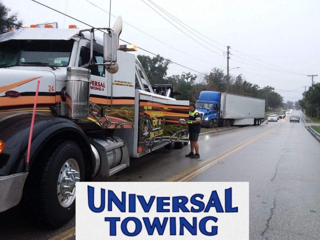 the universal towing heavy towing holly hill team hauling a semi out of sand