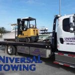 Forklift Moving in Action by Universal Towing