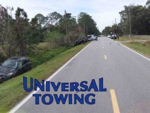 New Smyrna Beach Towing Services in action before sedan is winched out