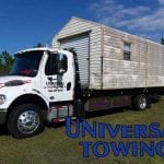 Tow truck service using flatbed with shed