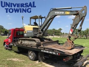 Construction Equipment Towing an Excavator